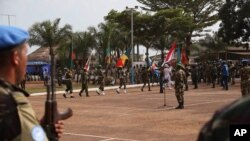 FILE - United Nations peace keeping troops take part in a ceremony in the capital city of Bangui, Central African Republic.