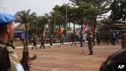 FILE - United Nations peacekeeping troops take part in a ceremony in the capital city of Bangui, Central African Republic.