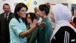 U.S. Ambassador to the United Nations Nikki Haley, second left, meets with Syrian refugee students, in Amman, Jordan, May 21, 2017.
