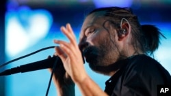 Thom York, lead singer of English rock band Radiohead, performs during their concert at the Optimus Alive music festival in Lisbon, Sunday, July 15 2012. (AP Photo/Armando Franca)