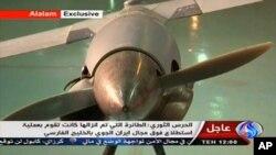 Imagen tomada de la televisión iraní que muestran lo que el gobierno de Teherán asegura es un avión no tripulado ScanEagle de Estados Unidos, el cual fue capturado en territorio israelí.
