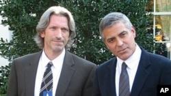 Actor, activist George Clooney (R) with activist John Prendergast