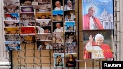 Postcards and calendars are displayed outside a shop at the Vatican, February 12, 2013.