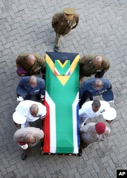The flag-draped casket carrying the remains of anti-apartheid icon Winnie Madikizela-Mandela arrives at the Orlando Stadium in Soweto, South Africa, April 14, 2018.