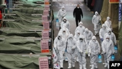 Market workers wearing protective gear spray disinfectant at a market in the southeastern city of Daegu on February 23, 2020 as a preventive measure after the COVID-19 coronavirus outbreak.