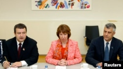 European Union foreign policy chief Catherine Ashton (C) poses with Serbia's Prime Minister Ivica Dacic (L) and Kosovo's Prime Minister Hashim Thaci, at NATO headquarters in Brussels, Belgium, April 19, 2013.