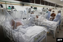 Healthcare workers and patients are shown inside the Intensive Care Unit for COVID-19 of the Gilberto Novaes Hospital in Manaus, Brazil, May 20, 2020.