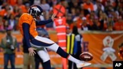 Denver Broncos punter Britton Colquitt punts during an NFL football game between the Denver Broncos and the Kansas City Chiefs.