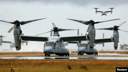 Four Ospreys from the U.S. Navy Ship (USNS) Charles Drew prepare to taxi on the tarmac of Tacloban airport in the aftermath of super typhoon Haiyan November 14, 2013.