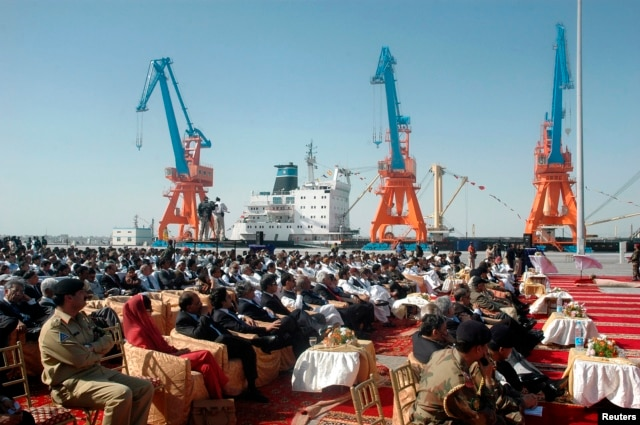 Participants attend the opening ceremony of the Gwadar deep-sea port on the Arabian Sea, west of Karachi, March 20, 2007