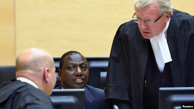 Kenyan Deputy President William Ruto (C) sits in the courtroom of the International Criminal Court in The Hague, May 14, 2013.