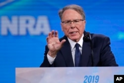 FILE - Nation Rifle Association Executive Vice President Wayne LaPierre speaks at the National Rifle Association Institute for Legislative Action Leadership Forum in Lucas Oil Stadium in Indianapolis, April 26, 2019.