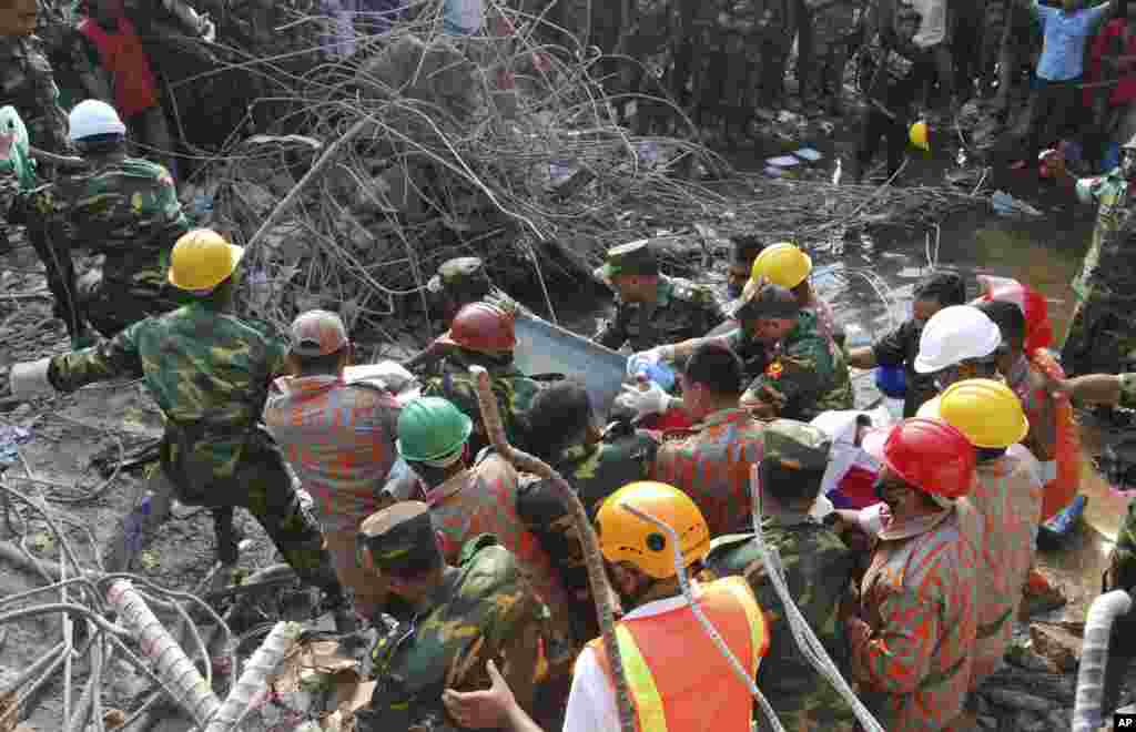 Rescuers carry a survivor pulled out from the rubble of a building that collapsed in Saver, near Dhaka, Bangladesh, May 10, 2013.