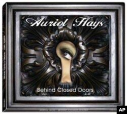 The cover of Hays's debut album, Behind Closed Doors