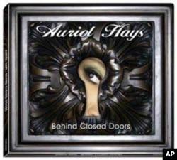The cover of Hays's debut album, Behind Closed Doors