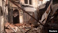 效忠于叙利亚阿萨德的军队2013年2月25日从自由叙利亚军手中夺回了阿勒颇的阿勒苏韦加地区之后,在该地区看到的断垣残壁。