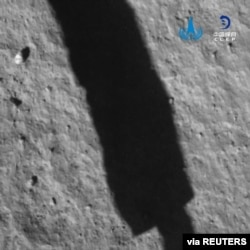 An image taken by the Chang'e 5 spacecraft after its landing on the moon is seen in this handout provided by China National Space Administration.
