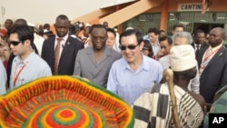 Taiwan's President Ma Ying-jeou (C) accompanied by Burkina Faso's Prime Minister Luc Adolph Tiao visits the vocational training center of reference (Centre de formation professionnelle de reference de Ziniare (CFPR-Z)) in Ziniare, 35kms of Ouagadougou on