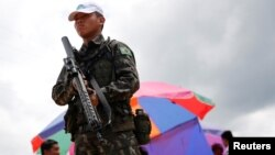 A Brazilian army soldier takes part in joint military training for humanitarian actions with U.S., Colombian and Peruvian soldiers, in Tabatinga, Brazil, Nov. 8, 2017.
