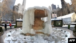 The Josephine Shaw Lowell Fountain in Bryant Park in New York remains frozen, Feb. 20, 2015.