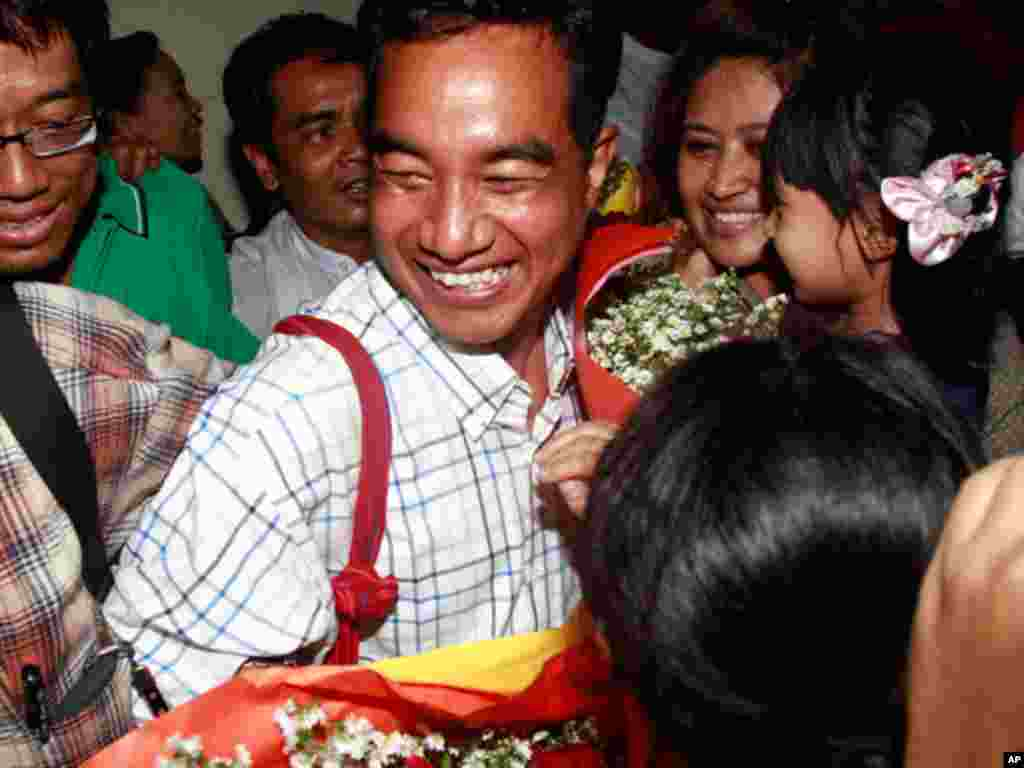 Zaw Thet Htway, a journalist who was arrested during the 2007 Saffron Revolution, is welcomed by his colleagues after being released from prison. (AP)