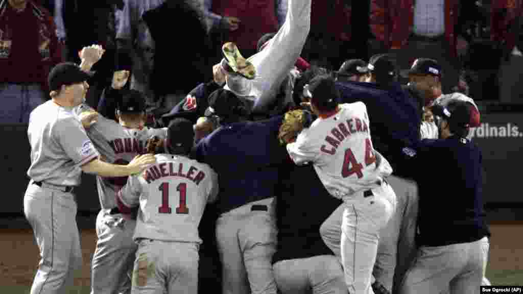 Boston Red Sox players celebrate after beating the St. Louis Cardinals 3-0 in Game 4 to sweep the World Series Wednesday, Oct. 27, 2004, in St. Louis. It was the first World Series championship for Boston since 1918.