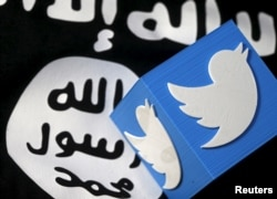 A 3-D printed logo of Twitter and an Islamic State flag are seen in this picture illustration taken Feb. 18, 2016.