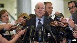 Senate Armed Service Committee member Sen. John McCain, speaks to reporters on Capitol Hill, July 8, 2014.