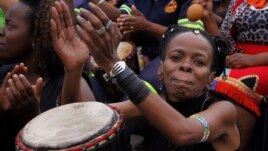 Women take part in a drumming session in downtown Johannesburg, Friday, March 8, 2013 to protest against violence against women and children.