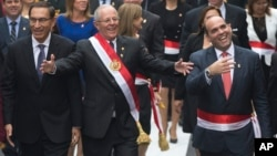Peru's President Pedro Pablo Kuczynski, center, walks with Prime Minister Fernando Zavala, right, and first Vice President Martin Vizcarra, left, to Congress in Lima, Peru, July 28, 2017. Kuczynski delivered his first State of the Nation address to Congr