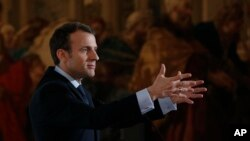 French President Emmanuel Macron speaks at the Elysee Palace in Paris, March 26, 2018.