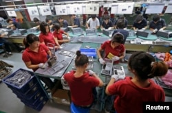 Employees work at a Foxconn factory in Wuhan, Hubei province, China, Aug. 31, 2012.