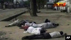 According to The Associated Press, Nigerian officials dumped dozens of corpses in front of a hospital after soldiers opened fire on civilians. Frame grab from TV footage shot by Nigeria's television authority shows people lying down (condition unknown) on a street in Maiduguri, Oct. 8, 2012.