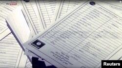 Những tài liệu xác định những người ủng hộ Nhà nước Hồi giáo được trích từ video phát hành bởi Sky News Reuters ở London, ngày 10 tháng 3 năm 2016.