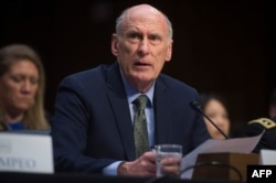 FILE - Director of National Intelligence Dan Coats testifies during a Senate Intelligence Committee hearing on Capitol Hill in Washington, Feb. 13, 2018.