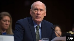 FILE - Director of National Intelligence Dan Coats testifies on worldwide threats during a Senate Intelligence Committee hearing on Capitol Hill in Washington, Feb. 13, 2018.