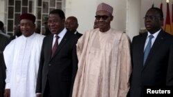Niger's President Mahamaduo Issoufou, Benin's President Boni Yayi, Nigeria's President Muhammadu Buhari, and Senegalese President and Chairman of Economic Community of West African States (ECOWAS) Macky Sall attend an ECOWAS heads of state summit on the political crisis in Burkina Faso, in Abuja, Nigeria, Sept. 22, 2015.