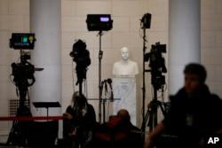 FILE - Television news equipment near a hearing room Monday, Dec. 9, 2019, on Capitol Hill in Washington. (AP Photo/Patrick Semansky)