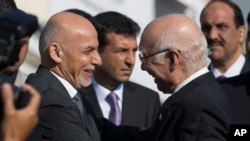 FILE - Sartaj Aziz, Pakistan's advisor on national security and foreign affairs, right, greets Afghan President Ashraf Ghani at Chaklala airbase in Rawalpindi, Pakistan, Nov. 14, 2014.