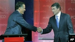 Republican presidential candidates former Massachusetts Governor Mitt Romney (L), and Texas Governor Rick Perry shake hands at the finish of a Republican presidential candidate debate at the Ronald Reagan Presidential Library in Simi Valley, California, S