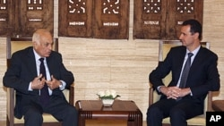 Syrian President Bashar al-Assad, right, meets with Arab League Secretary-General Nabil Elaraby at al-Shaab presidential palace in Damascus, Syria, Wednesday, July 13, 2011
