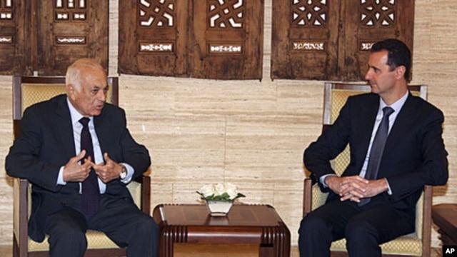 Syrian President Bashar al-Assad, right, meets with Arab League Secretary-General Nabil Elaraby at al-Shaab presidential palace in Damascus, Syria, Wednesday, July 13, 2011