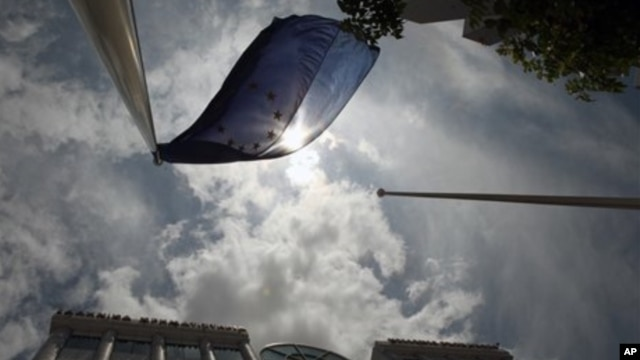 A European Union flag flies outside the stock exchange in Athens, Greece, May  2012.
