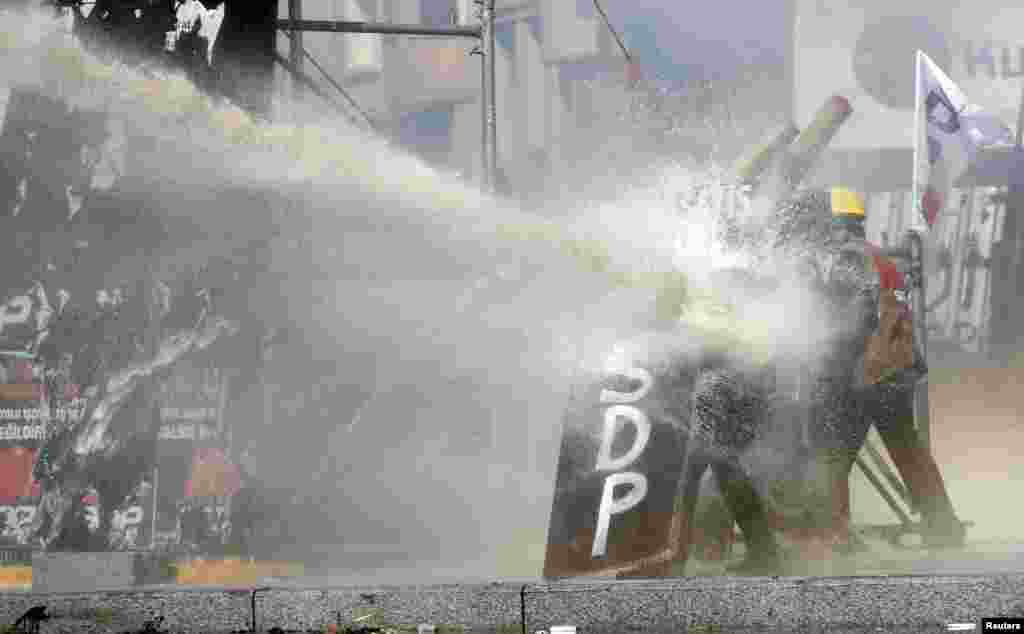 A crowd control vehicle fires a water cannon against protesters in Taksim Square in Istanbul, June 11, 2013.