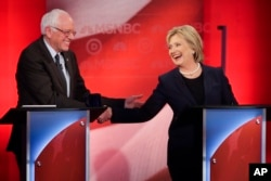 Democratic presidential candidates Senator Bernie Sanders and former Secretary of State Hillary Clinton shake hands during a Democratic presidential primary debate at the University of New Hampshire in Durham, Feb. 4, 2016.