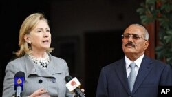 Yemeni President Ali Abdullah Saleh, right, listens to U.S. Secretary of State Hillary Rodham Clinton, as she speaks during a media conference in Sanaa, Yemen, 11 Jan. 2011