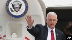 FILE - Vice President Mike Pence waves before leaving for Japan, at Osan Air Base in Pyeongtaek, South Korea, , April 18, 2017.