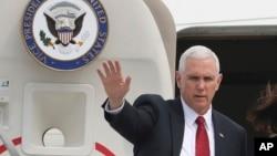 FILE - Vice President Mike Pence waves before leaving for Japan, at Osan Air Base in Pyeongtaek, South Korea, , April 18, 2017.