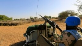 FILE - A United Nations peacekeeper is seen on patrol in Sudan's Darfur region.
