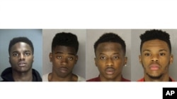 From left to right, Daniel Russell, Christen Glenn, King Edwards, and Hosea Moore are accused of killing 31-year-old Somali taxi driver Ramadhan Mohamed during a robbery in Pittsburgh.